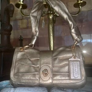 Coach rose gold leather bag